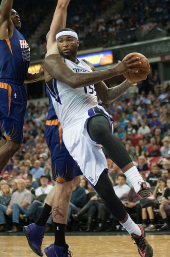 Oct 17, 2013; Sacramento, CA, USA; Sacramento Kings center DeMarcus Cousins (15) drives to the basket against the Phoenix Suns during the fourth quarter at Sleep Train Arena. The Sacramento Kings defeated the Phoenix Suns 107-90 Mandatory Credit: Ed Szczepanski-USA TODAY Sports