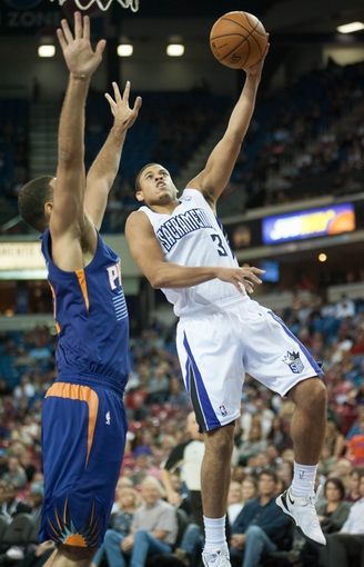 Oct 17, 2013; Sacramento, CA, USA; Sacramento Kings point guard Ray McCallum (3) attempts a shot against the Phoenix Suns during the fourth quarter at Sleep Train Arena. The Sacramento Kings defeated the Phoenix Suns 107-90 Mandatory Credit: Ed Szczepanski-USA TODAY Sports