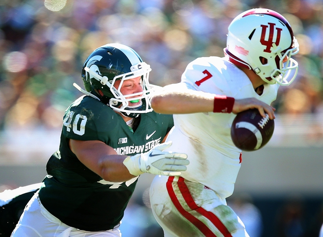 Oct 12, 2013; East Lansing, MI, USA; Michigan State Spartans linebacker Max Bullough (40) attempts to sack Indiana Hoosiers quarterback Nate Sudfeld (7) during the first half in a game at Spartan Stadium. Mandatory Credit: Mike Carter-USA TODAY Sports