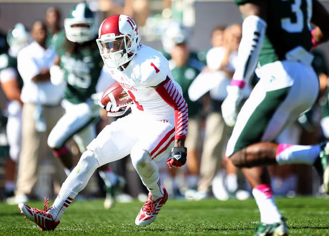 Oct 12, 2013; East Lansing, MI, USA; Indiana Hoosiers wide receiver Shane Wynn (1) runs for yards after the catch against Michigan State Spartans during the second half in a game at Spartan Stadium. MSU won 42-28. Mandatory Credit: Mike Carter-USA TODAY Sports