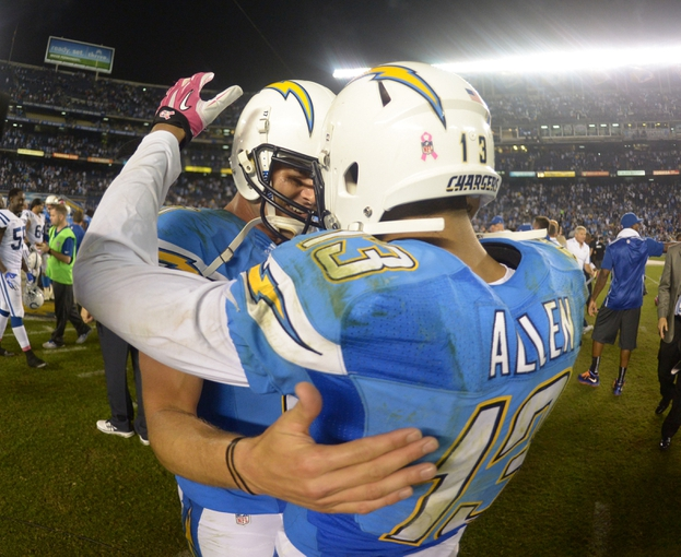 Oct 14, 2013; San Diego, CA, USA; San Diego Chargers quarterback Philip Rivers (17) and receiver Keenan Allen (13) embrace at the end of the game against the Indianapolis Colts at Qualcomm Stadium. The Chargers defeated the Colts 19-9. Mandatory Credit: Kirby Lee-USA TODAY Sports