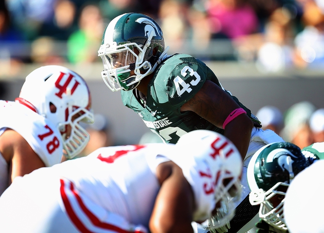 Oct 12, 2013; East Lansing, MI, USA; Michigan State Spartans linebacker Ed Davis (43) looks over Indiana Hoosiers offense during the second half in a game at Spartan Stadium. MSU won 42-28. Mandatory Credit: Mike Carter-USA TODAY Sports