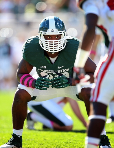 Oct 12, 2013; East Lansing, MI, USA; Michigan State Spartans defensive end Shilique Calhoun (89) prepares for the snap of the ball against Indiana Hoosiers offense during the first half in a game at Spartan Stadium. Mandatory Credit: Mike Carter-USA TODAY Sports