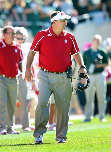 Oct 12, 2013; East Lansing, MI, USA; Indiana Hoosiers head coach Kevin Wilson  walks the sidelines during the first half of a game between the Michigan State Spartans and the Indiana Hoosiers at Spartan Stadium. Mandatory Credit: Mike Carter-USA TODAY Sports