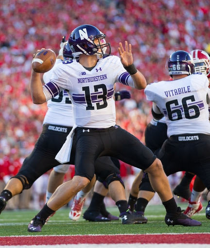 Oct 12, 2013; Madison, WI, USA; Northwestern Wildcats quarterback Trevor Siemian (13) during the game against the Wisconsin Badgers at Camp Randall Stadium.  Wisconsin won 35-6.  Mandatory Credit: Jeff Hanisch-USA TODAY Sports
