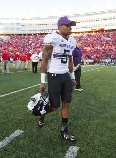 Oct 12, 2013; Madison, WI, USA; Northwestern Wildcats running back Venric Mark (5) walks off the field following the game against the Wisconsin Badgers at Camp Randall Stadium.  Wisconsin won 35-6.  Mandatory Credit: Jeff Hanisch-USA TODAY Sports
