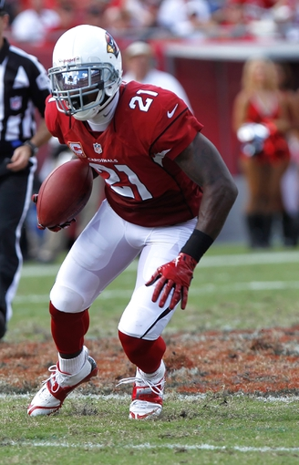 Sep 29, 2013; Tampa, FL, USA; Arizona Cardinals cornerback Patrick Peterson (21) runs with the ball against the Tampa Bay Buccaneers during the second half at Raymond James Stadium. Arizona Cardinals defeated the Tampa Bay Buccaneers 13-10. Mandatory Credit: Kim Klement-USA TODAY Sports
