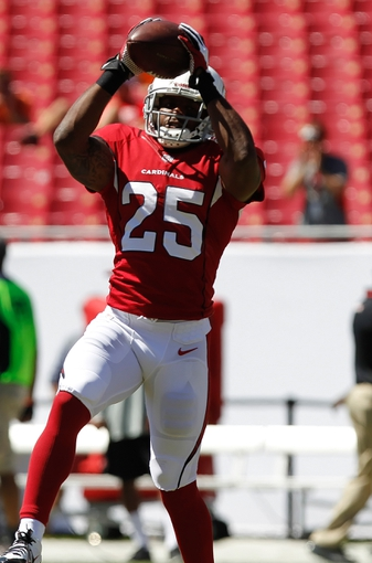 Sep 29, 2013; Tampa, FL, USA; Arizona Cardinals cornerback Jerraud Powers (25) against the Tampa Bay Buccaneers works out prior to the game at Raymond James Stadium. Mandatory Credit: Kim Klement-USA TODAY Sports