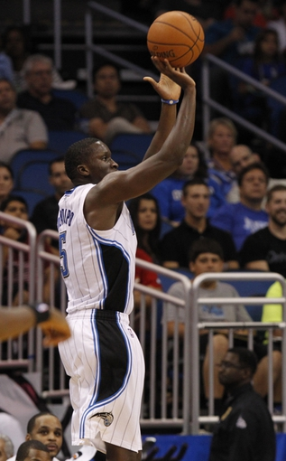 Oct 18, 2013; Orlando, FL, USA; Orlando Magic shooting guard Victor Oladipo (5) shoots a three pointer against the Memphis Grizzlies during the first half at Amway Center. Mandatory Credit: Kim Klement-USA TODAY Sports