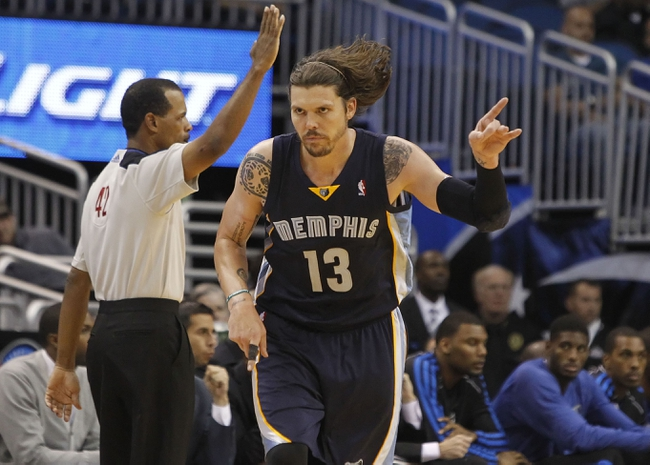 Oct 18, 2013; Orlando, FL, USA; Memphis Grizzlies small forward Mike Miller (13) reacts after he shot a three pointer against the Orlando Magic during the second half at Amway Center. Memphis Grizzlies defeated the Orlando Magic 97-91. Mandatory Credit: Kim Klement-USA TODAY Sports