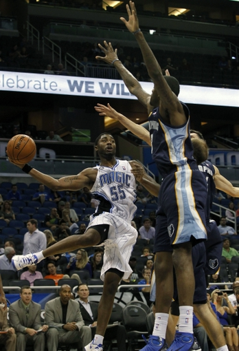 Oct 18, 2013; Orlando, FL, USA; Memphis Grizzlies point guard Keyon Dooling (55) passes the ball past Memphis Grizzlies power forward Willie Reed (3) during the second half at Amway Center. Memphis Grizzlies defeated the Orlando Magic 97-91. Mandatory Credit: Kim Klement-USA TODAY Sports