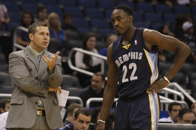 Oct 18, 2013; Orlando, FL, USA; Memphis Grizzlies head coach David Joerger talks with shooting guard Jamaal Franklin (22) against the Orlando Magic during the second half at Amway Center. Memphis Grizzlies defeated the Orlando Magic 97-91. Mandatory Credit: Kim Klement-USA TODAY Sports