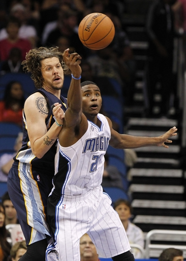 Oct 18, 2013; Orlando, FL, USA; Memphis Grizzlies small forward Mike Miller (13) and Orlando Magic small forward Maurice Harkless (21) go after the loose ball during the second half at Amway Center. Memphis Grizzlies defeated the Orlando Magic 97-91. Mandatory Credit: Kim Klement-USA TODAY Sports