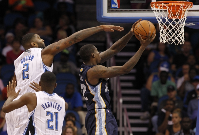 Oct 18, 2013; Orlando, FL, USA; Orlando Magic power forward Kyle O'Quinn (2) fouls Memphis Grizzlies power forward Ed Davis (32) during the second half at Amway Center. Memphis Grizzlies defeated the Orlando Magic 97-91. Mandatory Credit: Kim Klement-USA TODAY Sports