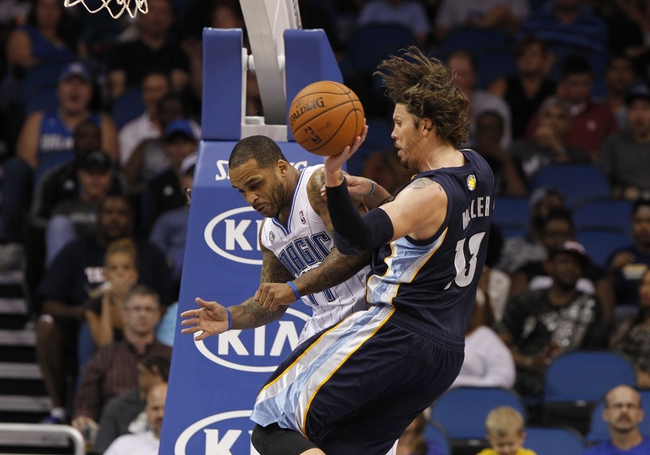 Oct 18, 2013; Orlando, FL, USA; Memphis Grizzlies small forward Mike Miller (13) throws the ball as Orlando Magic point guard Jameer Nelson (14) defends during the second half at Amway Center. Memphis Grizzlies defeated the Orlando Magic 97-91. Mandatory Credit: Kim Klement-USA TODAY Sports