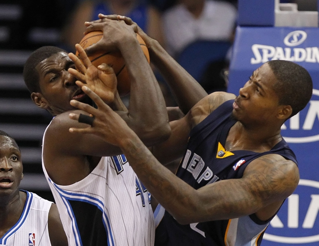 Oct 18, 2013; Orlando, FL, USA; Orlando Magic power forward Andrew Nicholson (44) and Memphis Grizzlies power forward Ed Davis (32) go after the ball during the second half at Amway Center. Memphis Grizzlies defeated the Orlando Magic 97-91. Mandatory Credit: Kim Klement-USA TODAY Sports