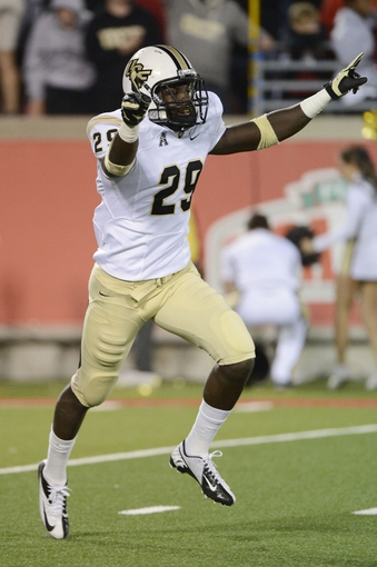Oct 18, 2013; Louisville, KY, USA; UCF Knights defensive back D.J. Killings (29) celebrates after defeating the Louisville Cardinals in the second half of play at Papa John's Cardinal Stadium. Central Florida defeated Louisville 38-35.  Mandatory Credit: Jamie Rhodes-USA TODAY Sports