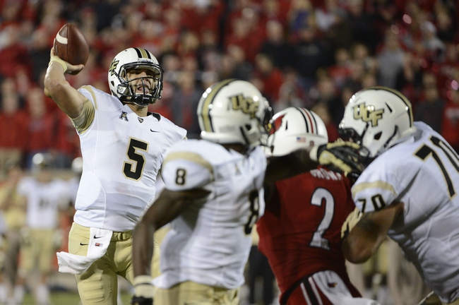 Oct 18, 2013; Louisville, KY, USA; UCF Knights quarterback Blake Bortles (5) throws the game winning touch down pass during the second half of play against the  Louisville Cardinals at Papa John's Cardinal Stadium. Central Florida defeated Louisville 38-35.  Mandatory Credit: Jamie Rhodes-USA TODAY Sports