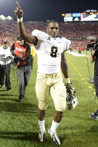 Oct 18, 2013; Louisville, KY, USA; UCF Knights running back Storm Johnson (8) celebrates after defeating the Louisville Cardinals in the second half of play at Papa John's Cardinal Stadium. Central Florida defeated Louisville 38-35.  Mandatory Credit: Jamie Rhodes-USA TODAY Sports