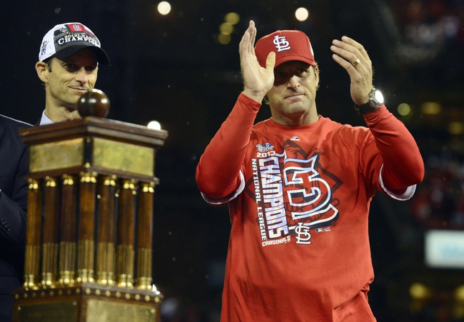 Oct 18, 2013; St. Louis, MO, USA; St. Louis Cardinals manager Mike Matheny (right) celebrates next to the National League championship trophy after game six of the National League Championship Series baseball game against the Los Angeles Dodgers at Busch Stadium. Mandatory Credit: Jeff Curry-USA TODAY Sports