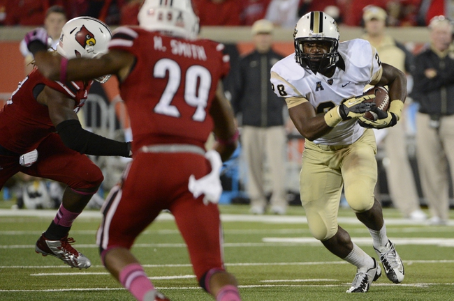 Oct 18, 2013; Louisville, KY, USA; UCF Knights running back William Stanback (28) runs the ball against the Louisville Cardinals during the second half of play at Papa John's Cardinal Stadium. Central Florida defeated Louisville 38-35.  Mandatory Credit: Jamie Rhodes-USA TODAY Sports