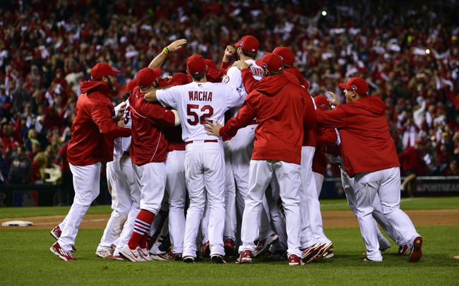 Oct 18, 2013; St. Louis, MO, USA; Members of the St. Louis Cardinals including Michael Wacha (52) celebrate on the field after game six of the National League Championship Series baseball game against the Los Angeles Dodgers at Busch Stadium. Mandatory Credit: Scott Rovak-USA TODAY Sports