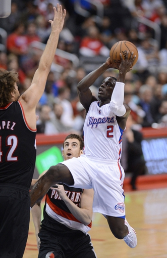 Oct 18, 2013; Los Angeles, CA, USA;  Portland Trail Blazers center Robin Lopez (42) guards Los Angeles Clippers point guard Darren Collison (2) in the second quarter of the game at the Staples Center. Mandatory Credit: Jayne Kamin-Oncea-USA TODAY Sports