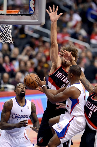 Oct 18, 2013; Los Angeles, CA, USA;  Portland Trail Blazers point guard Damian Lillard (0) and center Robin Lopez (42) defend as Los Angeles Clippers point guard Chris Paul (3) passes to center DeAndre Jordan (6) in the second quarter of the game at the Staples Center. Mandatory Credit: Jayne Kamin-Oncea-USA TODAY Sports