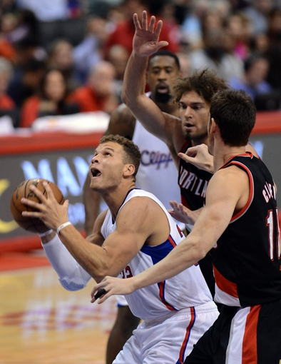 Oct 18, 2013; Los Angeles, CA, USA;  Portland Trail Blazers center Robin Lopez (42) and Portland Trail Blazers center Meyers Leonard (11) defend Los Angeles Clippers power forward Blake Griffin (32) in the second quarter of the game at the Staples Center. Mandatory Credit: Jayne Kamin-Oncea-USA TODAY Sports