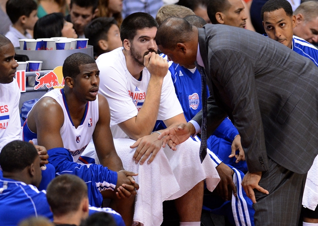 Oct 18, 2013; Los Angeles, CA, USA; Los Angeles Clippers head coach Doc Rivers talks to point guard Chris Paul (3) in the second quarter of the game against the Portland Trail Blazers at the Staples Center. Mandatory Credit: Jayne Kamin-Oncea-USA TODAY Sports