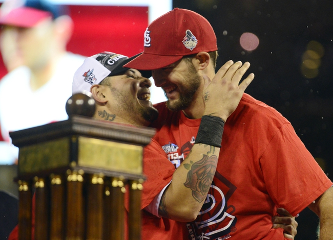 Oct 18, 2013; St. Louis, MO, USA; St. Louis Cardinals starting pitcher Michael Wacha (right) celebrates with catcher Yadier Molina (left) after game six of the National League Championship Series baseball game against the Los Angeles Dodgers at Busch Stadium. Mandatory Credit: Jeff Curry-USA TODAY Sports