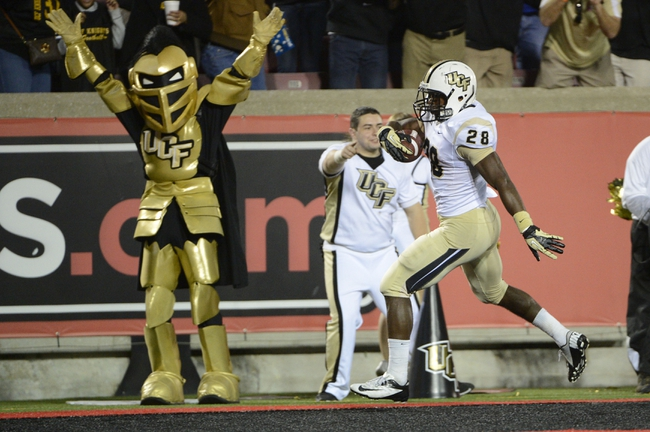 Oct 18, 2013; Louisville, KY, USA; UCF Knights running back William Stanback (28) runs in a touch down during the second half of play against the Louisville Cardinals at Papa John's Cardinal Stadium. Central Florida defeated Louisville 38-35.  Mandatory Credit: Jamie Rhodes-USA TODAY Sports