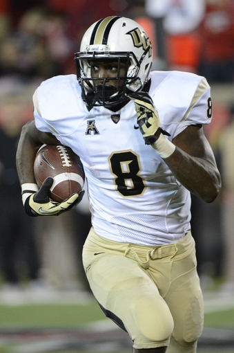Oct 18, 2013; Louisville, KY, USA; UCF Knights running back Storm Johnson (8) runs the ball against the Louisville Cardinals during the second half of play at Papa John's Cardinal Stadium. Central Florida defeated Louisville 38-35.  Mandatory Credit: Jamie Rhodes-USA TODAY Sports