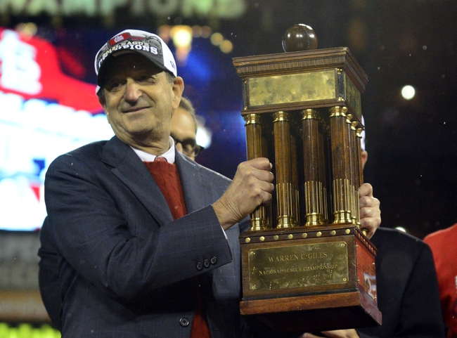 Oct 18, 2013; St. Louis, MO, USA; St. Louis Cardinals chairman William DeWitt, Jr. holds the National League championship trophy after game six of the National League Championship Series baseball game against the Los Angeles Dodgers at Busch Stadium. Mandatory Credit: Jeff Curry-USA TODAY Sports