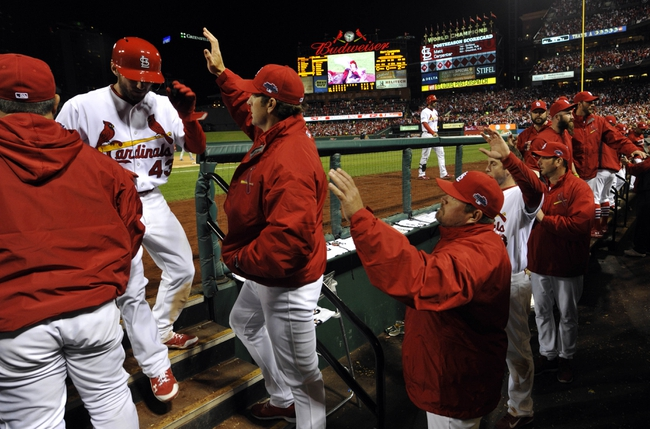 Oct 18, 2013; St. Louis, MO, USA; St. Louis Cardinals outfielder Shane Robinson (43) is welcomed back to the dugout after scoring a run in the fifth inning during game six of the National League Championship Series baseball game against the Los Angeles Dodgers at Busch Stadium. Mandatory Credit: Scott Rovak-USA TODAY Sports
