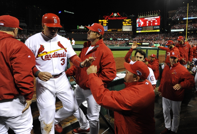 Oct 18, 2013; St. Louis, MO, USA; St. Louis Cardinals right fielder Carlos Beltran (3) is welcomed back to the dugout after scoring a run in the third inning during game six of the National League Championship Series baseball game against the Los Angeles Dodgers at Busch Stadium. Mandatory Credit: Scott Rovak-USA TODAY Sports