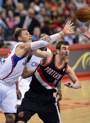 Oct 18, 2013; Los Angeles, CA, USA; Portland Trail Blazers small forward Victor Claver (18) and Los Angeles Clippers power forward Blake Griffin (32) go for a rebound in the second quarter of the game at the Staples Center. Mandatory Credit: Jayne Kamin-Oncea-USA TODAY Sports