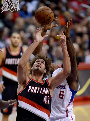 Oct 18, 2013; Los Angeles, CA, USA; Los Angeles Clippers center DeAndre Jordan (6) and Portland Trail Blazers center Robin Lopez (42) go for a rebound in the second half of the game at the Staples Center. Mandatory Credit: Jayne Kamin-Oncea-USA TODAY Sports