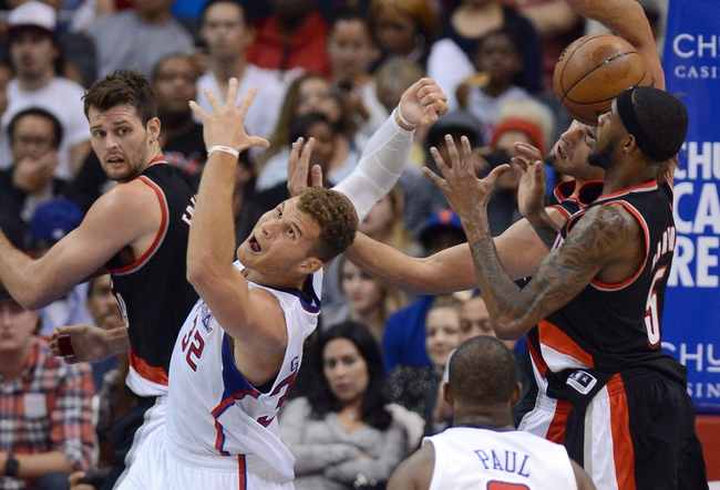 Oct 18, 2013; Los Angeles, CA, USA; Los Angeles Clippers power forward Blake Griffin (32), Portland Trail Blazers center Robin Lopez (42) and shooting guard Will Barton (5) go for a rebound in the second half of the game at the Staples Center. Mandatory Credit: Jayne Kamin-Oncea-USA TODAY Sports