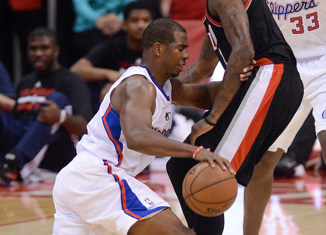 Oct 18, 2013; Los Angeles, CA, USA; Portland Trail Blazers small forward Dorell Wright (1) guards Los Angeles Clippers point guard Chris Paul (3) in the second half of the game at the Staples Center. Mandatory Credit: Jayne Kamin-Oncea-USA TODAY Sports