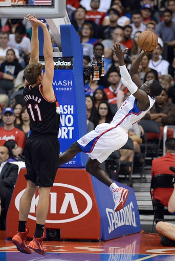 Oct 18, 2013; Los Angeles, CA, USA; Portland Trail Blazers center Meyers Leonard (11) guards Los Angeles Clippers point guard Darren Collison (2) in the second half of the game at the Staples Center. Mandatory Credit: Jayne Kamin-Oncea-USA TODAY Sports