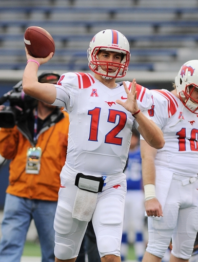 Oct 19, 2013; Memphis, TN, USA; Southern Methodist Mustangs quarterback Neal Burcham (12) warms up before the game against the Memphis Tigers at Liberty Bowl Memorial. Mandatory Credit: Justin Ford-USA TODAY Sports