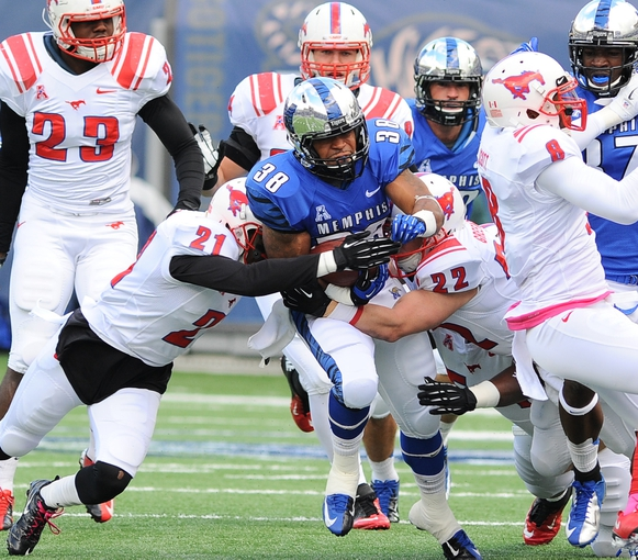 Oct 19, 2013; Memphis, TN, USA; Memphis Tigers running back Brandon Hayes (38) is tackled by Southern Methodist Mustangs defensive back Kenneth Acker (21) and defensive back Hayden Greenbauer (22) during the first quarter at Liberty Bowl Memorial. Mandatory Credit: Justin Ford-USA TODAY Sports