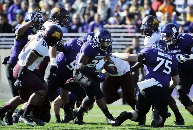 Oct 19, 2013; Evanston, IL, USA; Northwestern Wildcats running back Treyvon Green (22) runs against the Minnesota Golden Gophers during the first quarter at Ryan Field. Mandatory Credit: David Banks-USA TODAY Sports