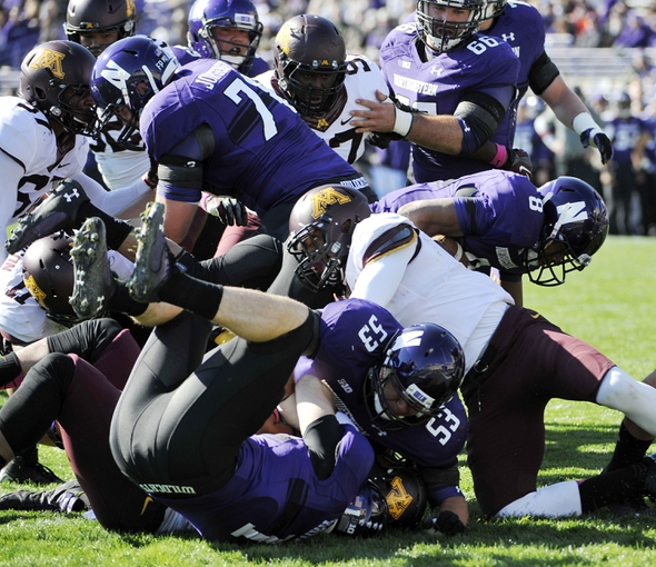 Oct 19, 2013; Evanston, IL, USA; Northwestern Wildcats running back Stephen Buckley (8) scores a touchdown against the Minnesota Golden Gophers during the first quarter at Ryan Field. Mandatory Credit: David Banks-USA TODAY Sports