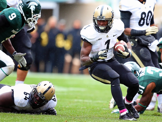 Oct 19, 2013; East Lansing, MI, USA; Purdue Boilermakers running back Akeem Hunt (1) runs the ball against the Michigan State Spartans during the 1st  half at Spartan Stadium. Mandatory Credit: Mike Carter-USA TODAY Sports