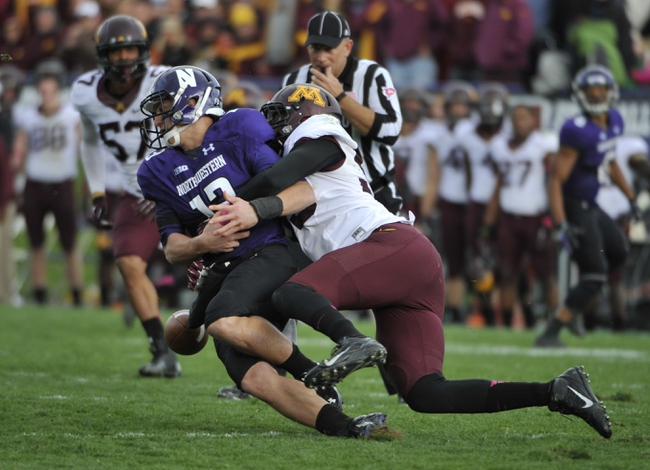 Oct 19, 2013; Evanston, IL, USA; Minnesota Golden Gophers defensive lineman Theiren Cockran (55) causes Northwestern Wildcats quarterback Trevor Siemian (13) to fumble during the second half at Ryan Field.  The Minnesota Golden Gophers defeated the Northwestern Wildcats 20-17. Mandatory Credit: David Banks-USA TODAY Sports