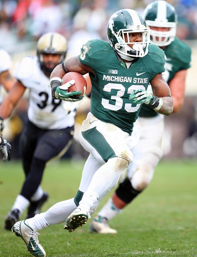 Oct 19, 2013; East Lansing, MI, USA; Michigan State Spartans running back Jeremy Langford (33) runs the ball against the Purdue Boilermakers during the 2nd half at Spartan Stadium. MSU won 14-0. Mandatory Credit: Mike Carter-USA TODAY Sports