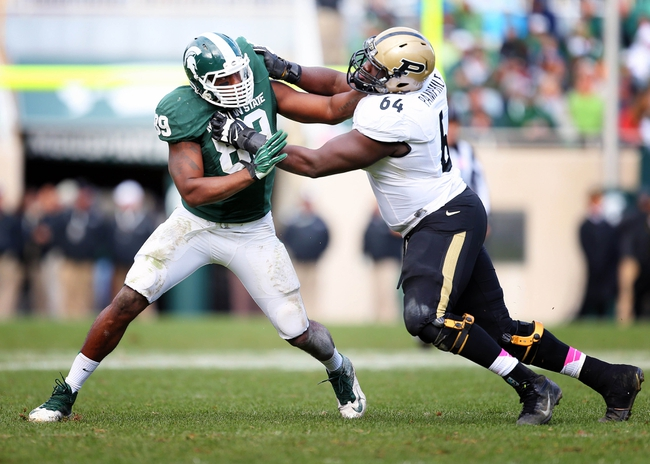 Oct 19, 2013; East Lansing, MI, USA; Michigan State Spartans defensive end Shilique Calhoun (89) defends against Purdue Boilermakers offensive tackle Kevin Pamphile (64) during the 2nd half at Spartan Stadium. MSU won 14-0. Mandatory Credit: Mike Carter-USA TODAY Sports