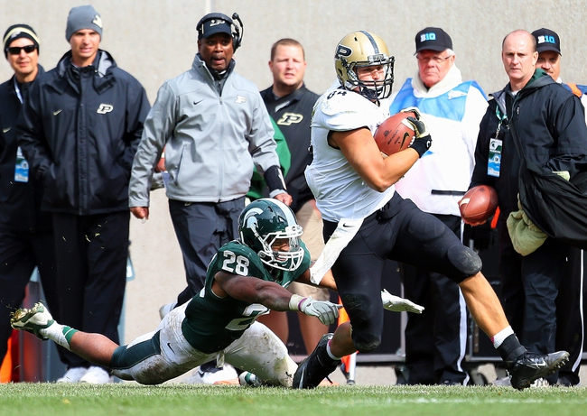 Oct 19, 2013; East Lansing, MI, USA; Purdue Boilermakers tight end Justin Sinz (84) runs for yards after the catch against Michigan State Spartans linebacker Denicos Allen (28) during the 2nd half at Spartan Stadium. MSU won 14-0. Mandatory Credit: Mike Carter-USA TODAY Sports